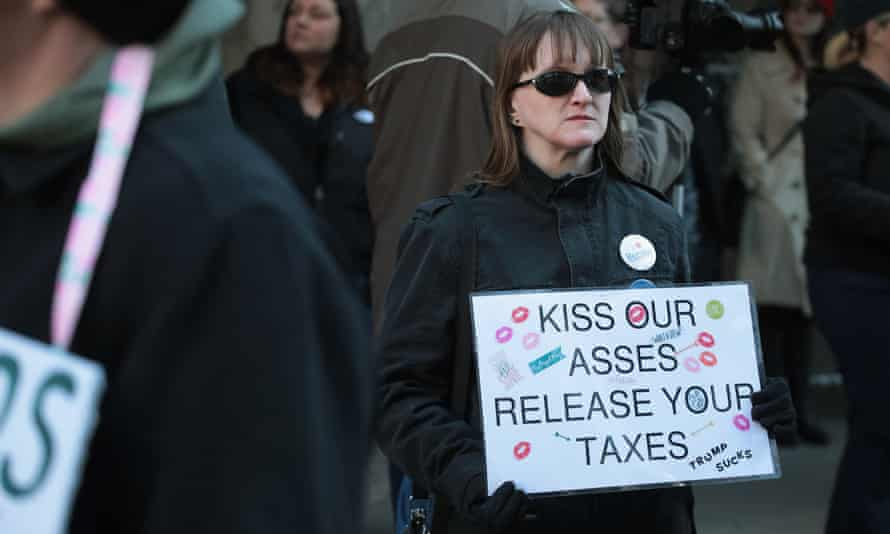 A protester urging Donald Trump to release his own tax returns.