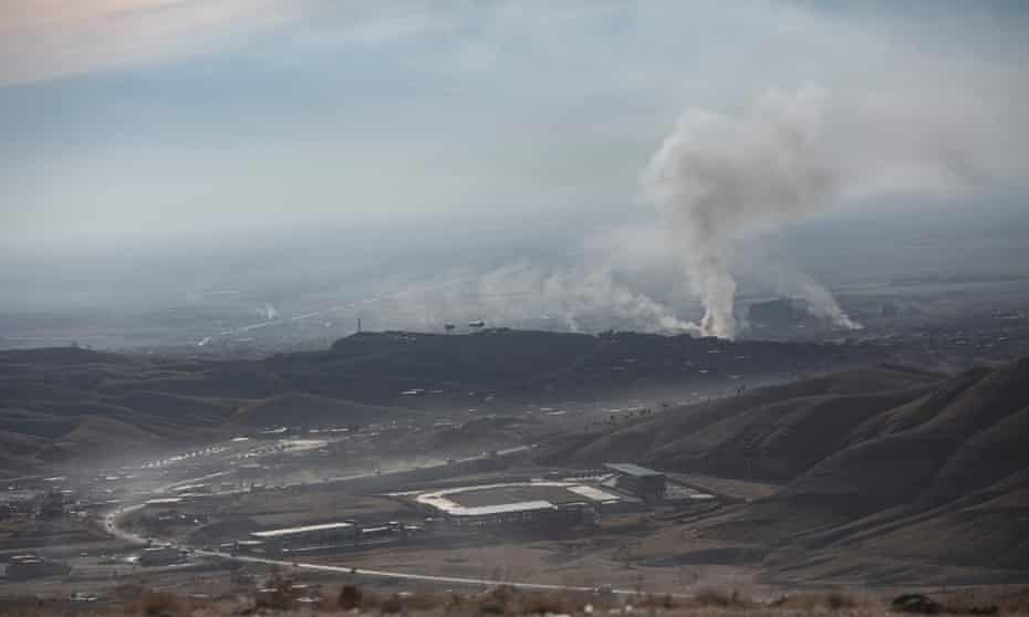 Smoke rises above Sinjar in November 2015 after it was recaptured from Isis.
