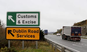 A lorry passes a sign outside Newry, Northern Ireland, pointing towards an old customs and excise station near the border with the Republic.