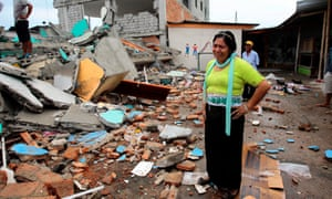 A woman in the middle of the debris of a collapsed building in the town of Pedernales, Ecuador