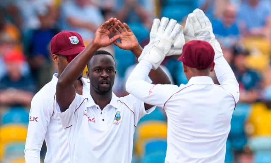 Kemar Roach celebrates taking the wicket of Jonny Bairstow