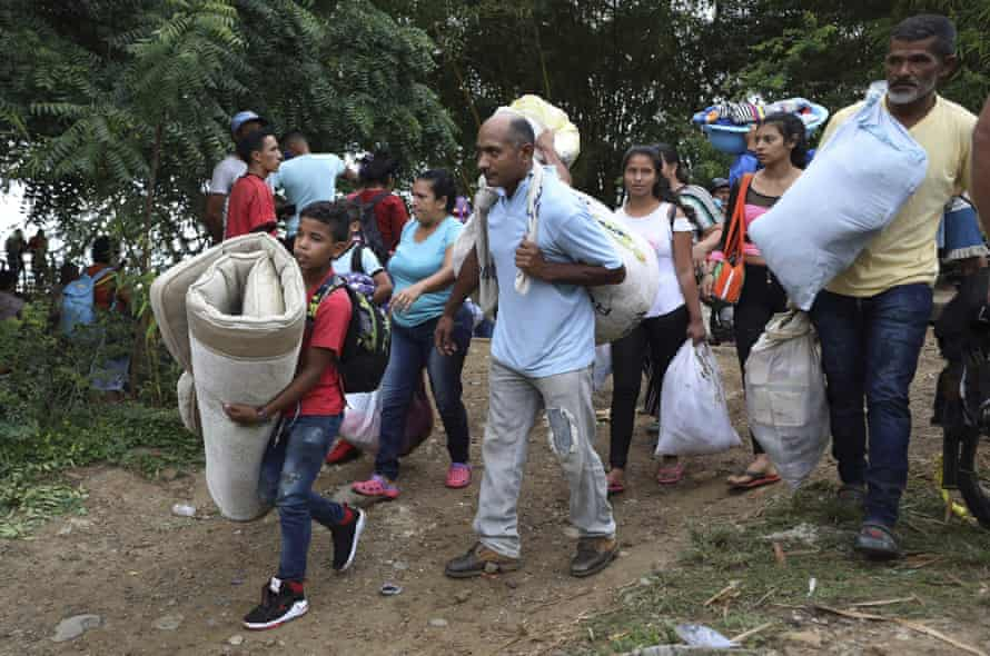 Venezuelans seek shelter in Colombia following clashes between Venezuela's military and a Colombian armed group.