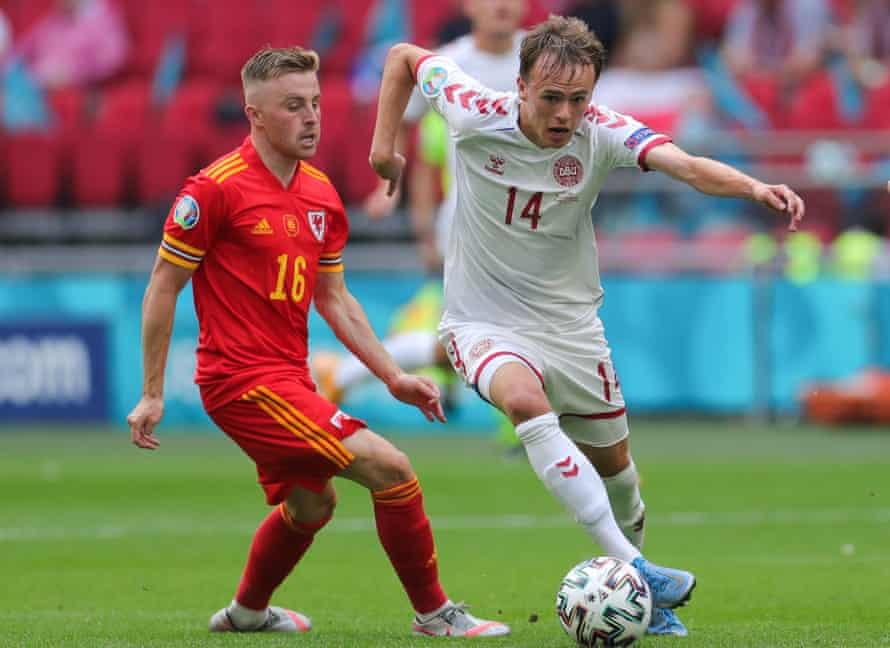 Mikkel Damsgaard breaks away from Joe Morrell during Denmark's Euro 2020 win over Wales.