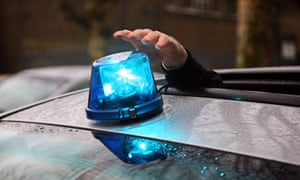 Blue light on roof of an undercover police car.