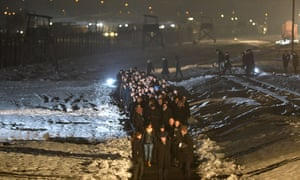 'It is quite astonishing how much of what is described in Mein Kampf was later realised' … a procession in memory of Holocaust victims at Auschwitz 70 years after its liberation.