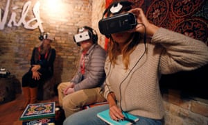 Visitors try out virtual reality kit at the Sundance Film Festival.