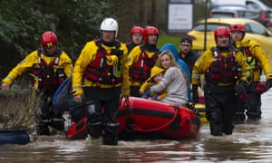 A family is rescued from Nantgarw, Wales, during Storm Dennis on 16 February.