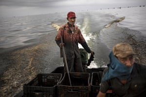 A fisherman navigates the oil-infested waters of Lake Maracaibo – the environmental fallout of Venezuela's collapsing oil industry.