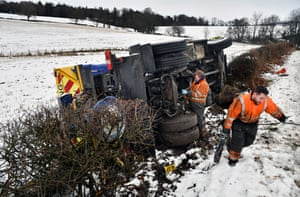 Men recover an overturned gritting lorry near Balfron Station, Scotland