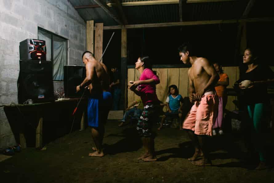 Shuar youth from the Ecuadorian side of the Santiago river rehearse for a traditional dance during an Ecuador-Peru binational meeting