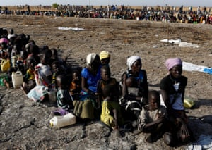 Women and children wait to be registered prior to a food distribution carried out by the United Nations World Food Programme in Thonyor, Leer state, South Sudan, February 26, 2017.