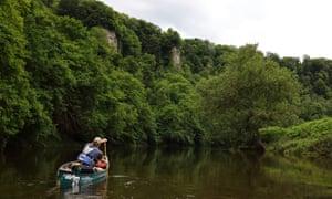 Stuart paddles towards the cliffs under Symonds Yat