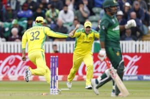 Glenn Maxwell runs and celebrates with Australia's captain Aaron Finch after running out Pakistan's captain Sarfaraz Ahmed to win the match.