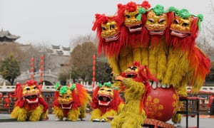 Folk artists perform a lion dance ahead of the Chinese Lunar New Year, or Spring festival, at Taierzhuang Ancient Town scenic area in Zaozhuang, Shandong province