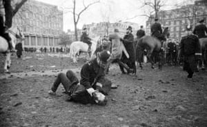 A policeman pins down an anti-Vietnam war demonstrator during riots at the US embassy in Grosvenor Square, London, in March 1968