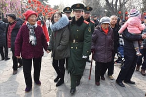 Chinese paramilitary police officers make their way through the crowds during New Year celebrations in Beijing.