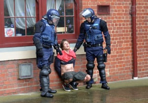 A 'True Blue Crew' member is apprehended by police officers during competing rallies held in Melbourne in May. The 'Say No To Racism' group and the 'Stop the Far Left' group clashed amid violent scenes – seven men were arrested and police had to use pepper spray to regain order.