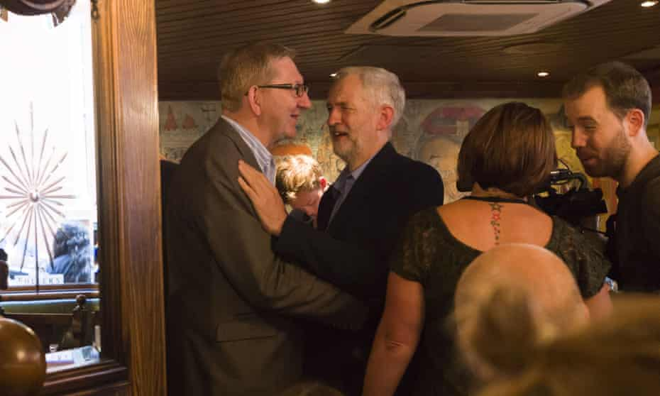 Jeremy Corbyn being congratulated by Len McCluskey after being elected as the leader of the Ladour Party.