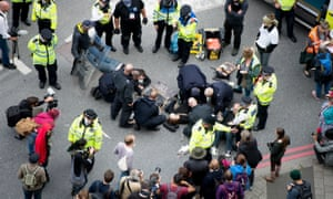 Activists protest against the Defence and Security Equipment international arms fair at the Excel centre in London.