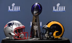 The Vince Lombardi Trophy and helmets for the New England Patriots and Los Angeles Rams on display in Atlanta