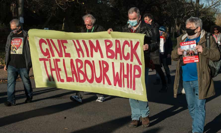 Members of the Labour party march through Finsbury Park in London in support of Jeremy Corbyn.