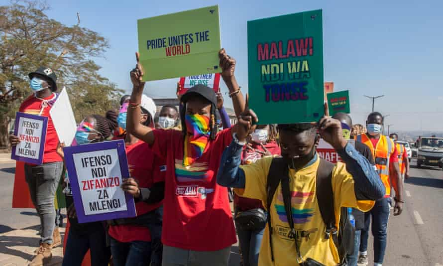 People take part in Malawi's first Pride parade in Lilongwe
