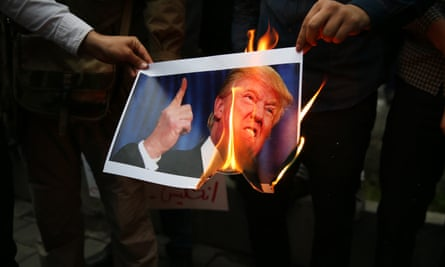 Iranians burn a photo of Donald Trump in Tehran.