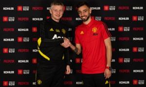 Bruno Fernandes is welcomed by Manchester United's manager, Ole Gunnar Solskjær.