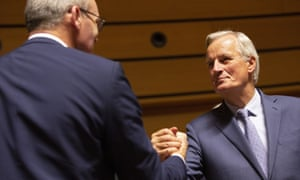 Michel Barnier shakes hands with the Irish foreign minister, Simon Coveney, at a meeting of ministers in Luxembourg.