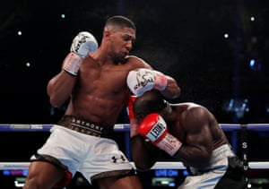 Anthony Joshua tussles with Carlos Takam.