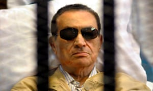 Hosni Mubarak in a cage in court during his trial in Cairo in 2012