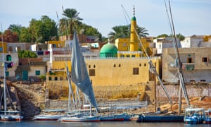 Feluccas, traditional wooden sailing boats, on the Nile at Aswan.