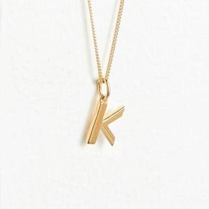 Gold letter, £45, Rachel Jackson at whistles.com
