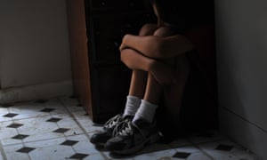 A child sitting on a floor