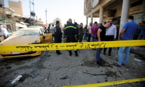 A police cordon at the site of a car bomb attack near a government office in Baghdad, Iraq, on Monday