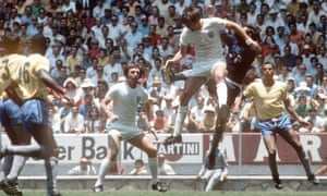 Jeff Astle, centre, playing for England in the 1970 World Cup against Brazil, died as a result of heading footballs, according to a coroner's report.