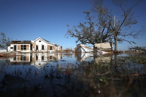 Flood waters surround structures destroyed by Hurricane Delta in Creole, Louisiana