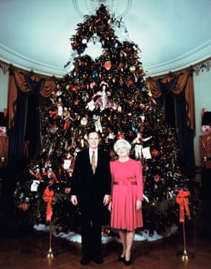 President George Bush and Mrs. Barbara Bush pose in front of the White House Christmas tree in the White House Blue Room Monday, Dec. 19,1990. (AP Photo/White House)
