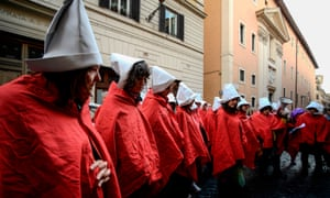 Members of the feminist alliance Non Una di Meno dress as handmaidens during a protest in Rome this month.