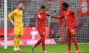 Bayern Munich's Serge Gnabry and Alphonso Davies (right)celebrate their fifth goal.