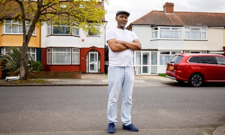 Anthony Bryan outside his home in north London.