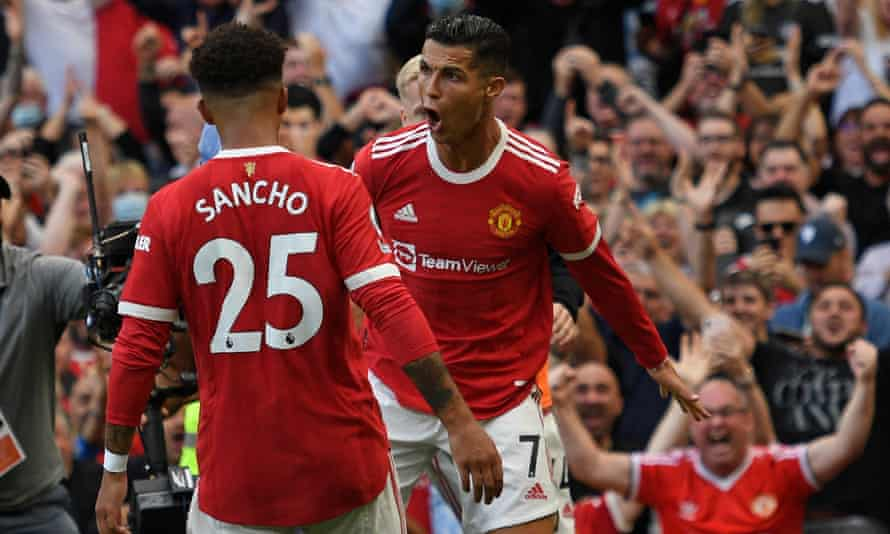 Cristiano Ronaldo celebrates with Jadon Sancho after scoring Manchester United's second goal against Newcastle at Old Trafford