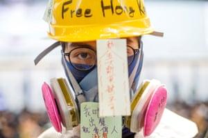 Hong Kong, China: A protester joins a rally at the airport