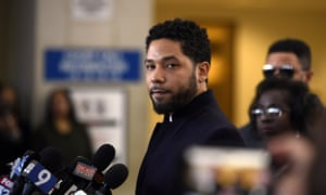 Actor Jussie Smollett talks to the media before leaving Cook county court in Chicago after his charges were dropped.