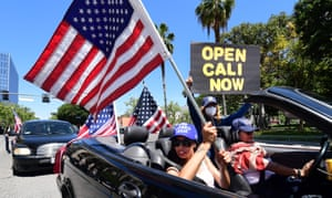 Protesters demand the government reopens the state during an Open California rally in Los Angeles