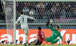 Cristiano Ronaldo lifts the ball over Kashima goalkeeper Hitoshi Sogahata.
