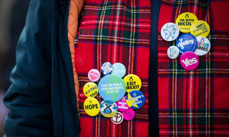 A protester wearing badges during a Scottish independence rally in George Square, Glasgow, May 1, 2021.