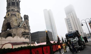 Emergency service personnel stand near the truck that crashed into the Christmas market near the Kaiser Wilhelm memorial church in Berlin