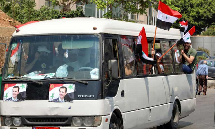 A bus in Beirut sporting flags in support of Bashar al-Assad.