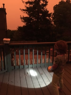 Kirsten Tranter's four year-old son shines a torch in Berkeley, California at 9.40am during the west coast wildfires, September 9